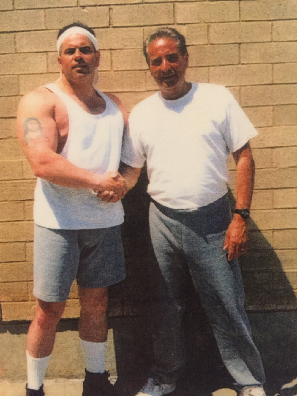 "Tony Fiore poses with New York City crime boss John A. ""Junior"" Gotti, left, in a federal prison yard.  Courtesy of The Providence Journal."