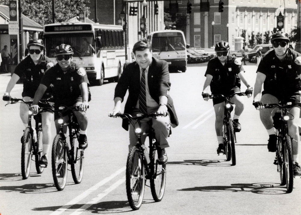 Buddy leads a bicycle brigade of police officers on mountain bikes around Kennedy Plaza in June 1991.  Courtesy of The Providence Journal/Sandor Bodo.