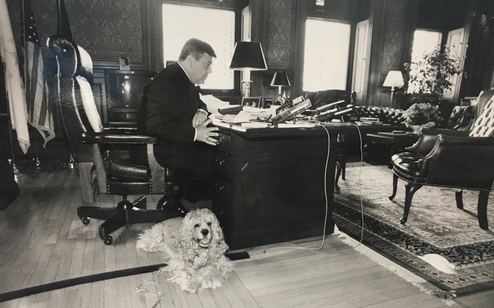 Buddy and his dog Tucker put in a day at City Hall. According to Mike Faella, Buddy would send his police security detail out to get hamburgers for his purebred cocker spaniels.  Courtesy of The Providence Journal/Bob Thayer.