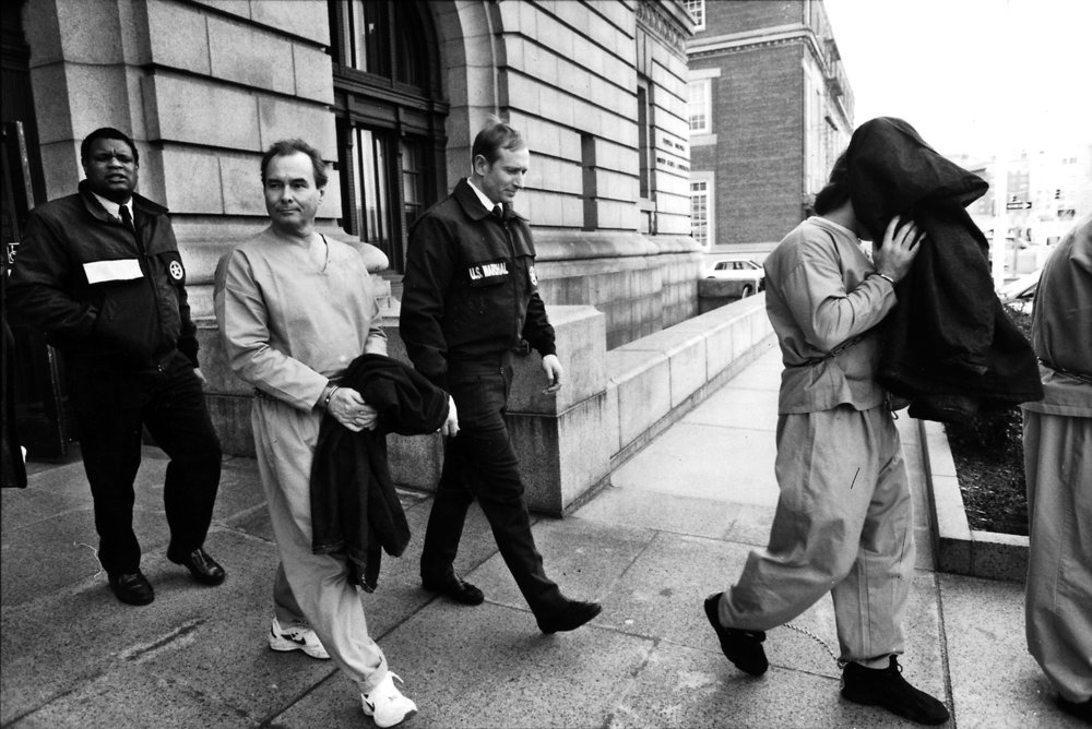 Flanked by federal marshals, Ouimette is returned to custody after his 1995 arraignment for extortion charges.  Courtesy of The Providence Journal.