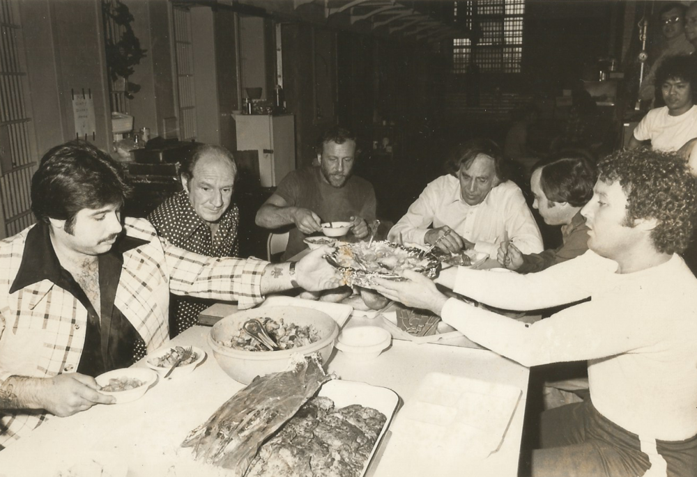 Ouimette, seated second from right, spent the 1970s in prison, but incarceration hardly slowed him down. He ran criminal enterprises from his cell, smuggled in alcohol, and enjoyed lavish dinners like the one pictured above.  Courtesy of The Providence Journal.