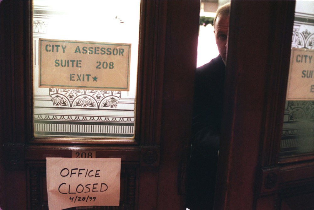 An FBI agent leaves the Tax Assessor's Office at Providence City Hall. In April 1999, investigators descended on five city offices with search warrants.  Courtesy of The Providence Journal/Bob Thayer.