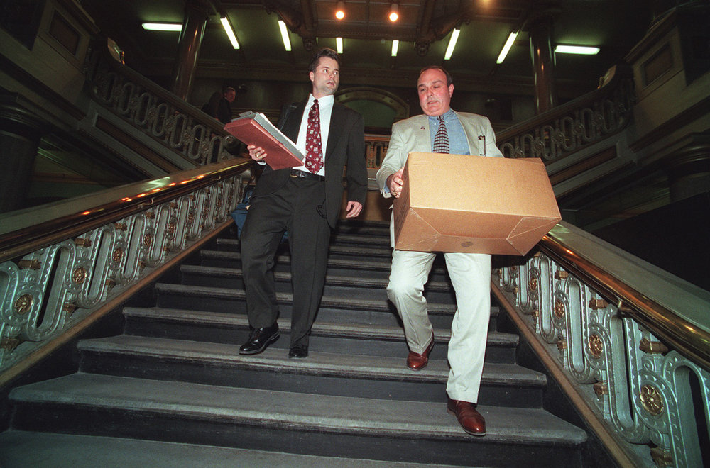 FBI agents leave Providence City Hall carrying boxes of evidence taken from the Tax Assessors office.  Courtesy of The Providence Journal/Ruben W. Perez.