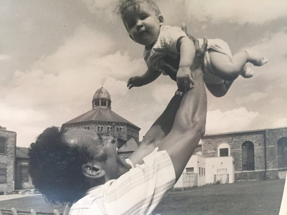 Ralph DeMasi struggled to remain close to his family as he cycled in and out of prison. Here, he plays with one of his children outside of the Adult Correctional Institutions.  Courtesy of Ralph DeMasi.