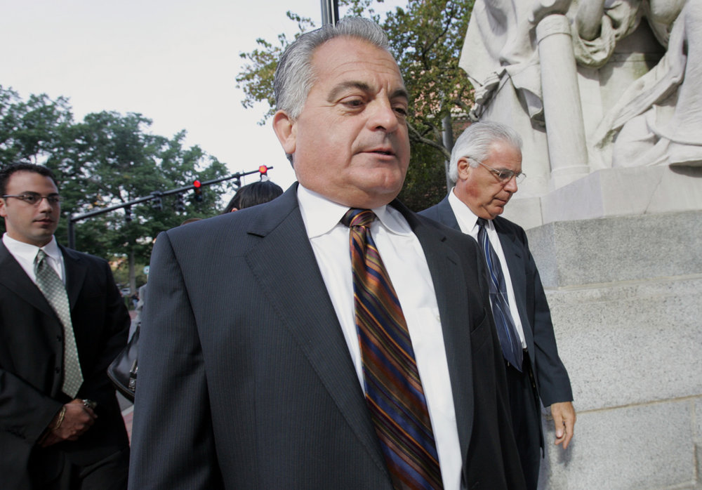 Bevilacqua was found guilty of criminal contempt and perjury for leaking FBI recordings to a reporter during the Plunder Dome trial. Above, Bevilacqua arrives at U.S. District Court in Providence. He was sentenced to 18 months in prison.  Courtesy of The Providence Journal/Mary Murphy.