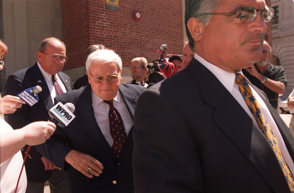 Bevilacqua, right, leaves U.S. District Court with his client Joseph Pannone in 2000. Pannone, who had been a city tax assessor, pleaded guilty to money-laundering and corruption charges in the Plunder Dome case, which also took down former mayor Buddy Cianci.  Courtesy of The Providence Journal/Mary Murphy.
