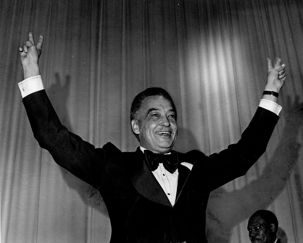 Coleman Young flashes the victory sign at his 1974 inaugural ball at Cobo Hall. Diana Ross performed at the event.  Courtesy of the Detroit Free Press.