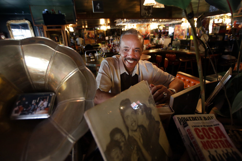 Larry Mongo is a fixture at Cafe D'Mongo's Speakeasy in downtown Detroit. The bar is filled with old photos and artifacts, many of which are crime-related.  Courtesy of the Detroit Free Press.