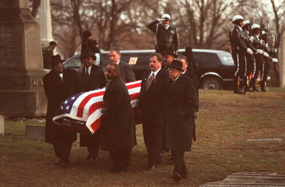 The casket of former Detroit Mayor Coleman Young arrives at Detroit's Elmwood Cemetery in December 1997.  Courtesy of the Detroit Free Press.