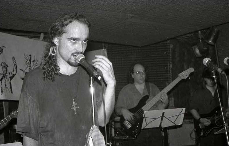 Dimitri Mugianis performing with his band Leisure Class in New York City in 1992. The band played in many underground clubs and bars. Along the way, Dimitri developed a drug addiction that lasted for decades.  Courtesy of Dimitri Mugianis /    Russ Johnson   .