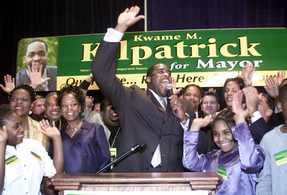 Detroit mayoral candidate Kwame Kilpatrick cheers with family and supporters on election day in 2001.  Courtesy of the Detroit Free Press.