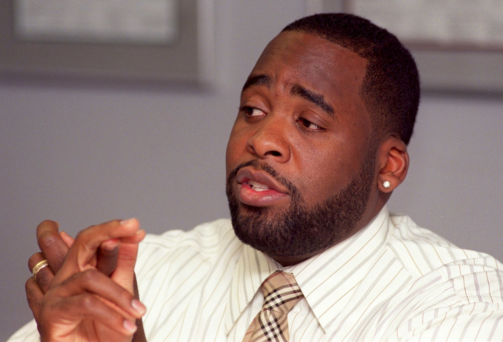 Kwame Kilpatrick refrained from wearing his diamond stud earring on the campaign trail, but put it back in once he assumed office. The earring set off a public debate about the mayor's youth and ability to lead.  Courtesy of the Detroit Free Press.