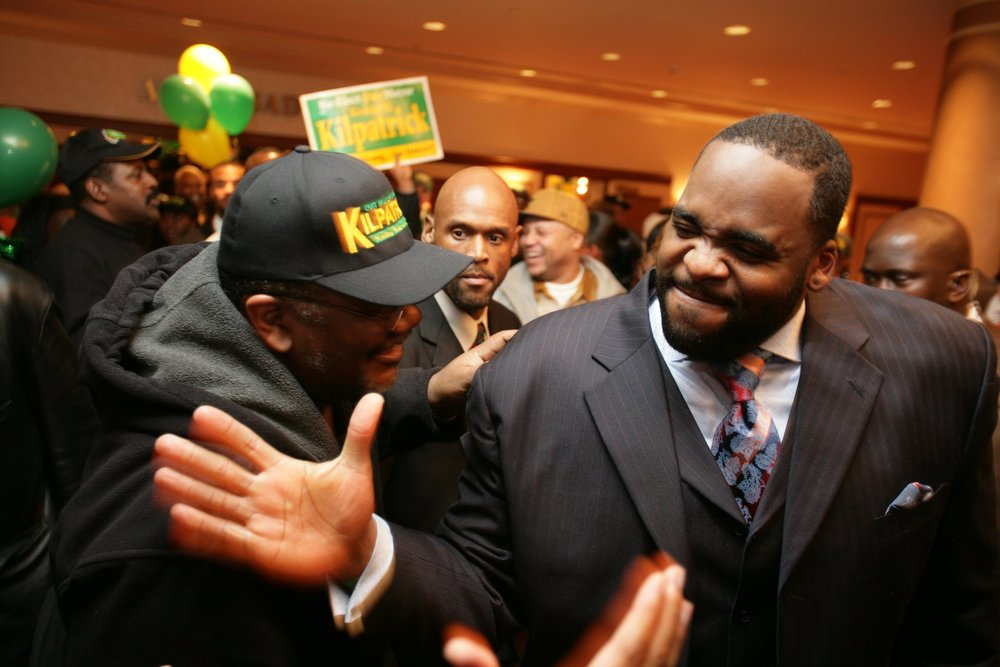 Mayor Kwame Kilpatrick celebrates his victory among family, friends, and volunteers at the Detroit Mariott Renaissance Center early in the morning following election day.  Courtesy of the Detroit Free Press.