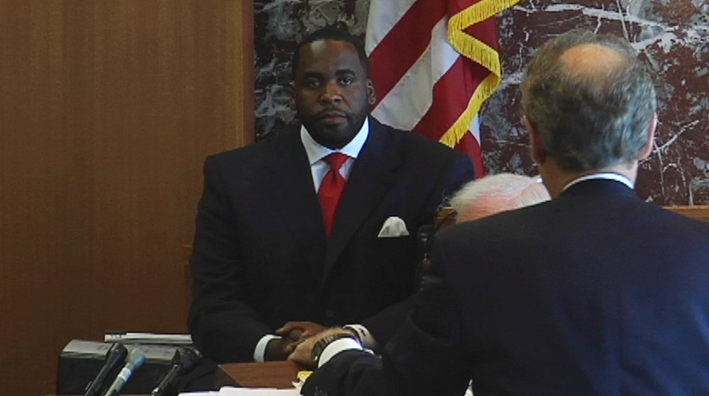 Mayor Kwame Kilpatrick testifies in Wayne County Circuit Court. In a civil lawsuit, Gary Brown, the head of Internal Affairs at the Detroit Police Department, claimed that Kilpatrick had ruined his career as an act of retribution.  Courtesy of the Detroit Free Press.