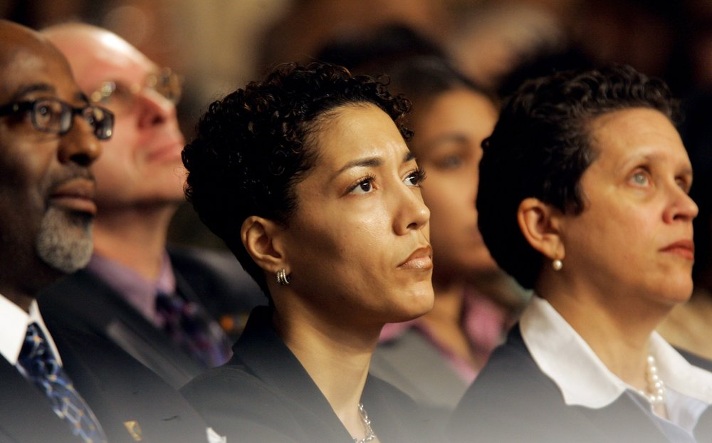 Chief of Staff Christine Beatty listens as Detroit Mayor Kwame Kilpatrick gives his State of the City Address in 2005.  Courtesy of the Detroit Free Press.