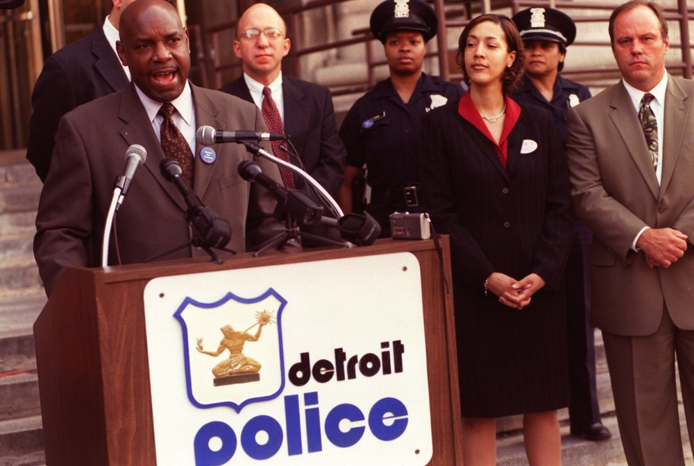 As chief of staff, Christine kept tabs on numerous city departments, including the Detroit Police Department. Here, she attends a 2002 press conference held by Police Chief Jerry Oliver, who would go on to testify in the Gary Brown whistleblower lawsuit in 2007.  Courtesy of the Detroit Free Press.