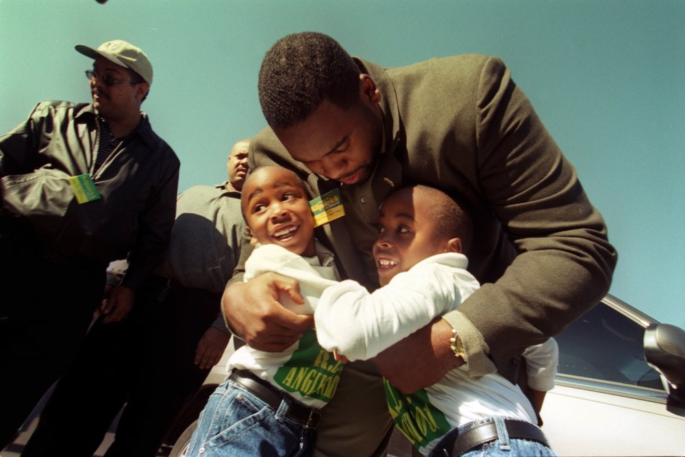 Kwame hugs his twin sons Jelani and Jalil on the campaign trail.   Christine and Kwame were close with each others families, attending birthday parties and buying Christmas presents for the kids.  Courtesy of the Detroit Free Press.