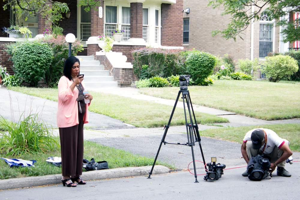 Reporters gather outside of the home of Carolyn Cheeks Kilpatrick on the day of Kwame's release from prison.  Courtesy of Tim and Tobias Smith.