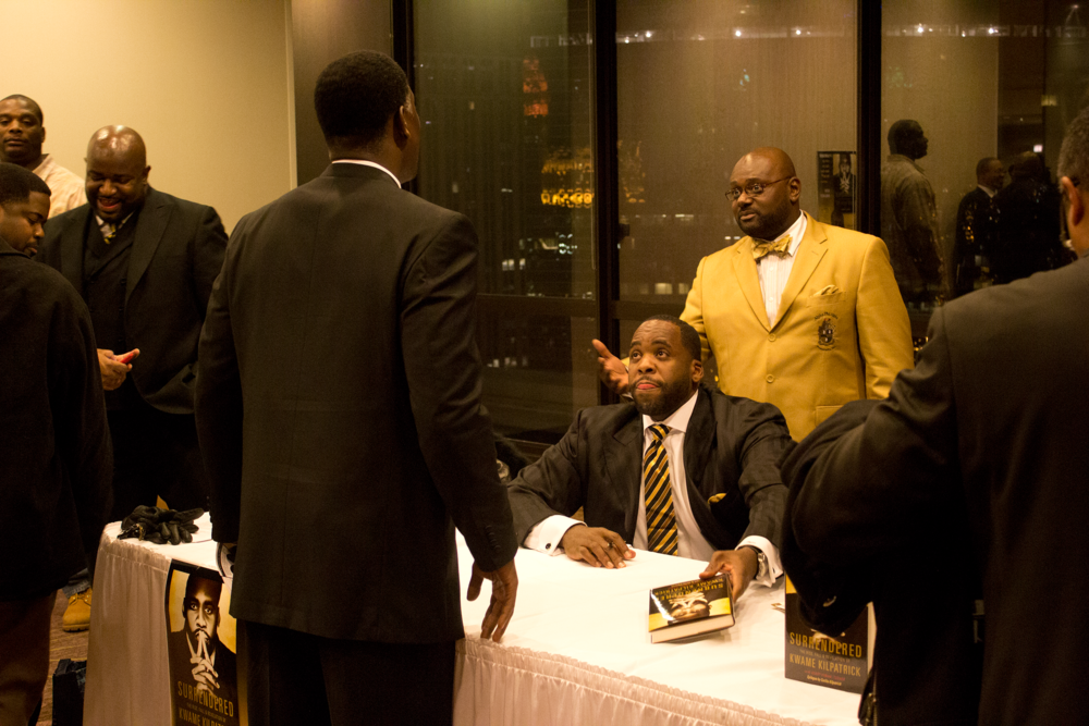 "Kwame Kilpatrick at a book signing for his 2011 memoir, ""Surrendered: The Rise, Fall and Revelation of Kwame Kilpatrick,"" which he co-wrote with his cousin-in-law, Khary Turner. The city ordered that profits from the book sales be put in an escrow account, to help pay out Kwame's remaining restitution obligations.  Courtesy of Tim and Tobias Smith."