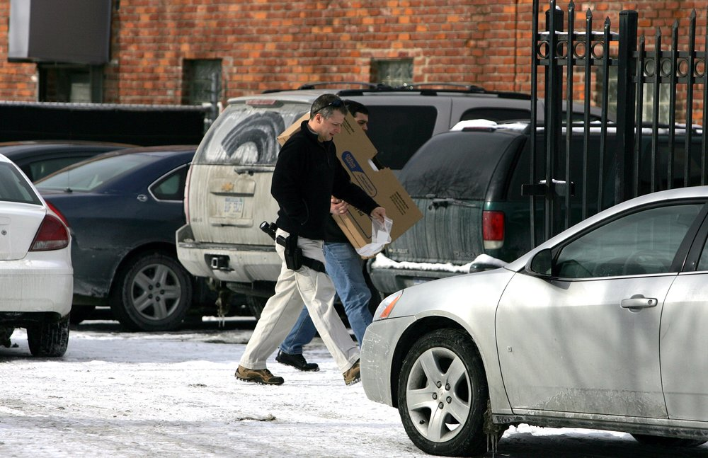 FBI Special Agent Bob Beeckman and another agent head into Ferguson Enterprises in Detroit in 2009 to conduct a search of the offices.  Courtesy of the Detroit Free Press.