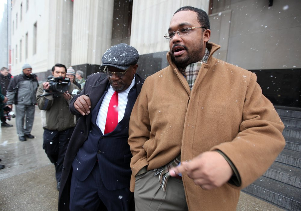 DeDan Milton, right, a former aide to Kwame Kilpatrick, leaves court with his lawyer. He testified in the federal trial after pleading guilty to bribery.  Courtesy of the Detroit Free Press.