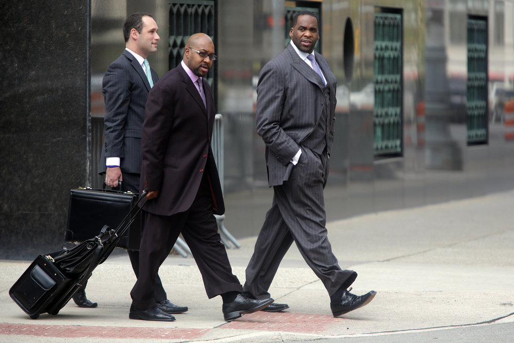 Kwame Kilpatrick and Bobby Ferguson outside of the federal courthouse. The jury handed down numerous guilty verdicts for both men. Kilpatrick was found guilty on 24 of 30 counts, and was later sentenced to 28 years in prison. Ferguson was found guilty on nine of 11 counts, and was sentenced to 21 years in prison.  Courtesy of the Detroit Free Press.