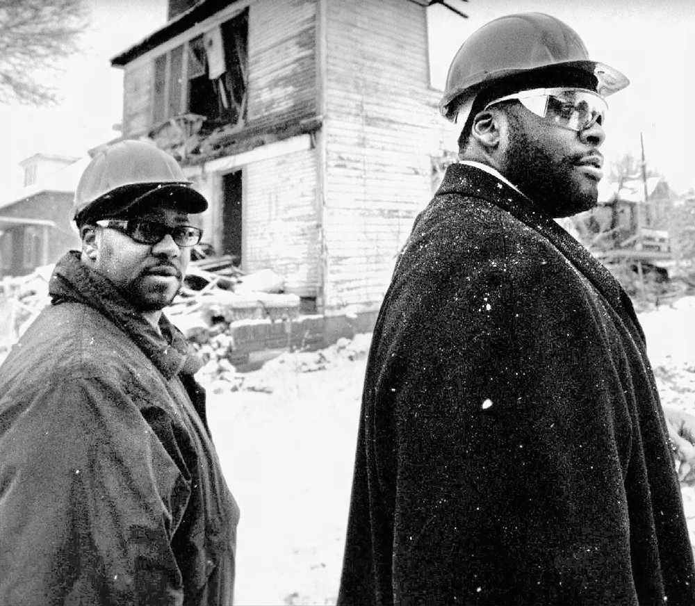 Contractor Bobby Ferguson and then-mayor Kwame Kilpatrick at a demolition site in 2002, as part of the city's Emergency Cleanup Initiative. The two men were later charged with bribery, extortion, and bid-rigging by the federal government as part of a sweeping RICO indictment.  Courtesy of the Detroit Free Press.