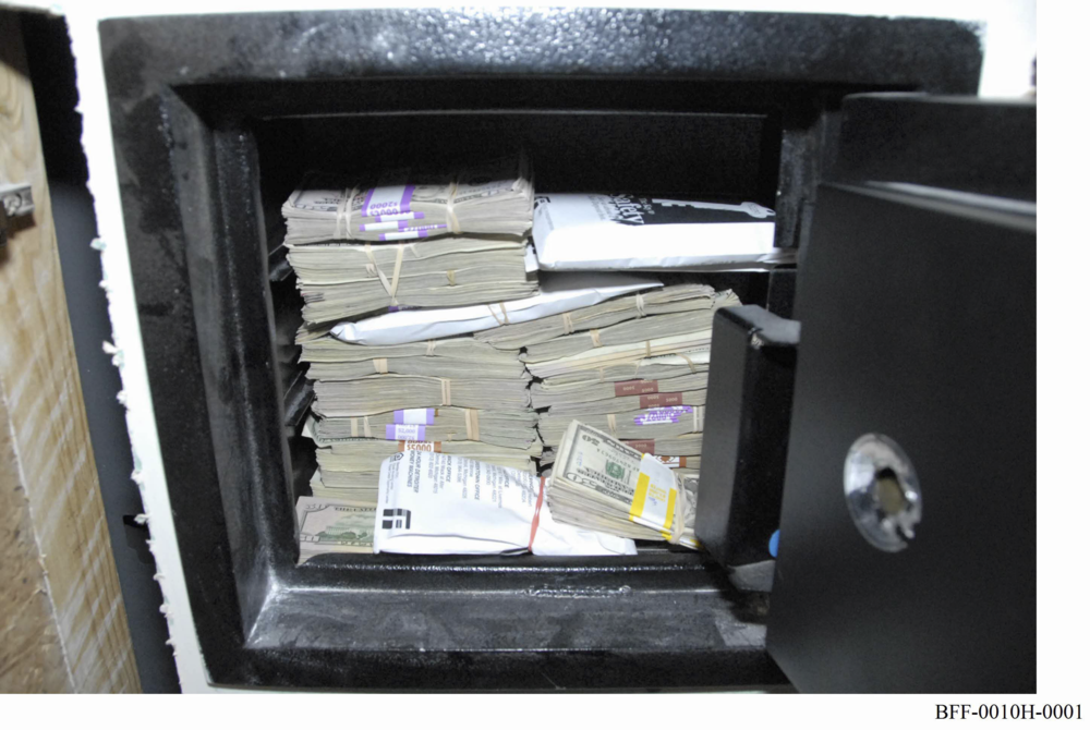 Federal investigators found this safe filled with cash hidden behind a wall panel in a bathroom in Bobby Ferguson's office. They discovered that Ferguson withdrew millions in cash from his company, and alleged that he used it to make payments to Kwame Kilpatrick.  Courtesy of Mark Chutkow.