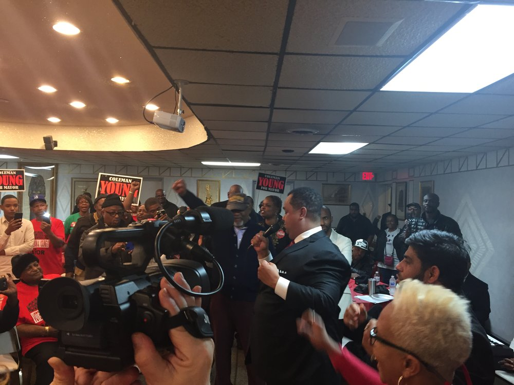Supporters gather around Coleman A. Young II at his Take Back the Motherland rally on the eve of the 2017 mayoral election. He was joined by several other speakers, including his campaign manager, Adolph Mongo, who created the controversial lynching ad for Kwame Kilpatrick in 2005.  Photo by John White.