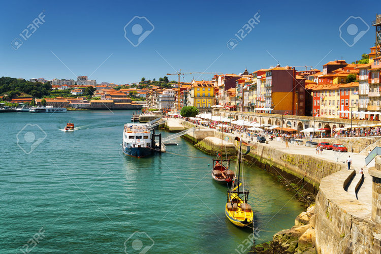 36253966-The-Douro-River-and-Colorful-facades-of-old-houses-on-embankment-in-Porto-Portugal-Porto-is-one-of-t-Stock-Photo.jpg