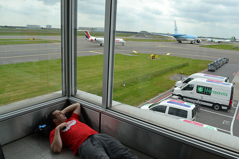 James naps in the corner of the terminal as we wait to board a flight to Denmark for the Copenhagen Marathon.