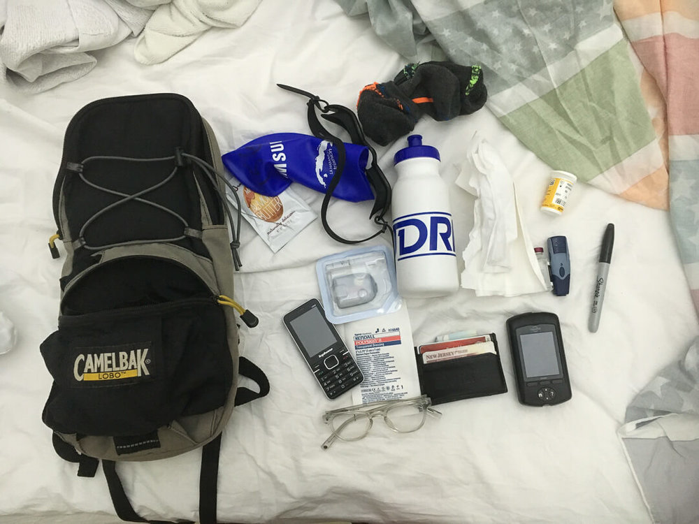 What does a diabetic bring for a triathlon? I use a camelback to hold testing equipment, extra food, and post-race items. The paper towel is to dry my hands off during the race for testing.