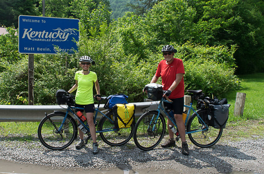 Doug and Donna pose at the Kentucky welcome sign.