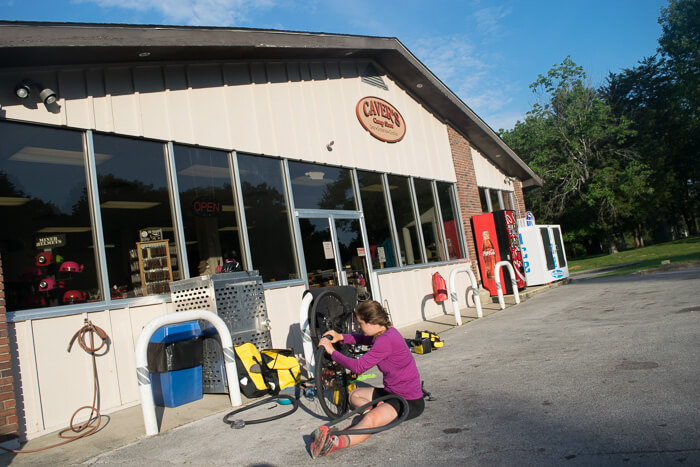 Taylor fixing her 7th flat outside the camp store at Mammoth Cave National Park
