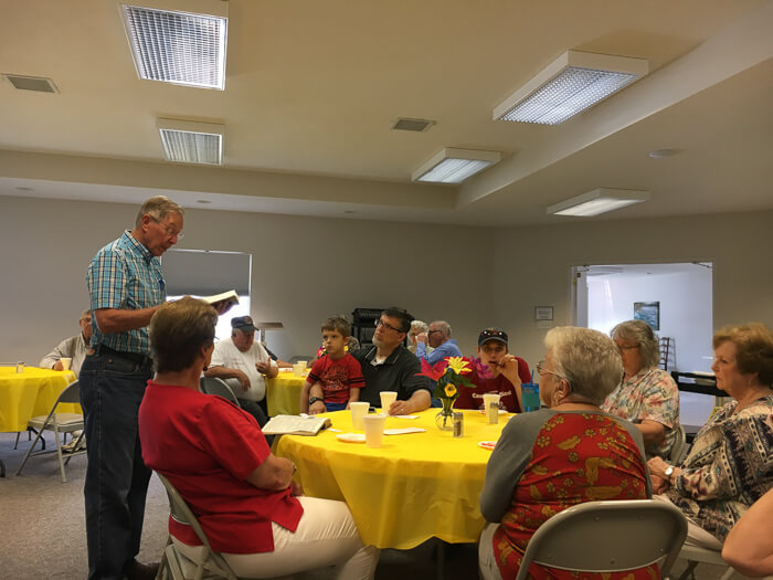 The community at Sebree First Baptist Church welcomes me for a lunch feast