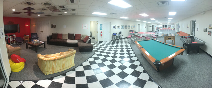 A panorama of the youth lounge that doubles as cyclist's paradise