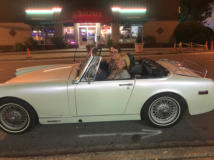 Lindy offers a ride in her '76 MG Midget