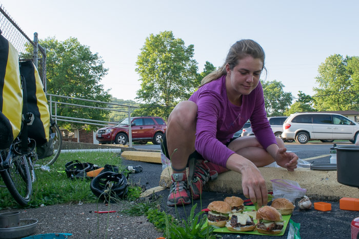 Taylor prepares vegeterian bean burgers in the parking lot of the church