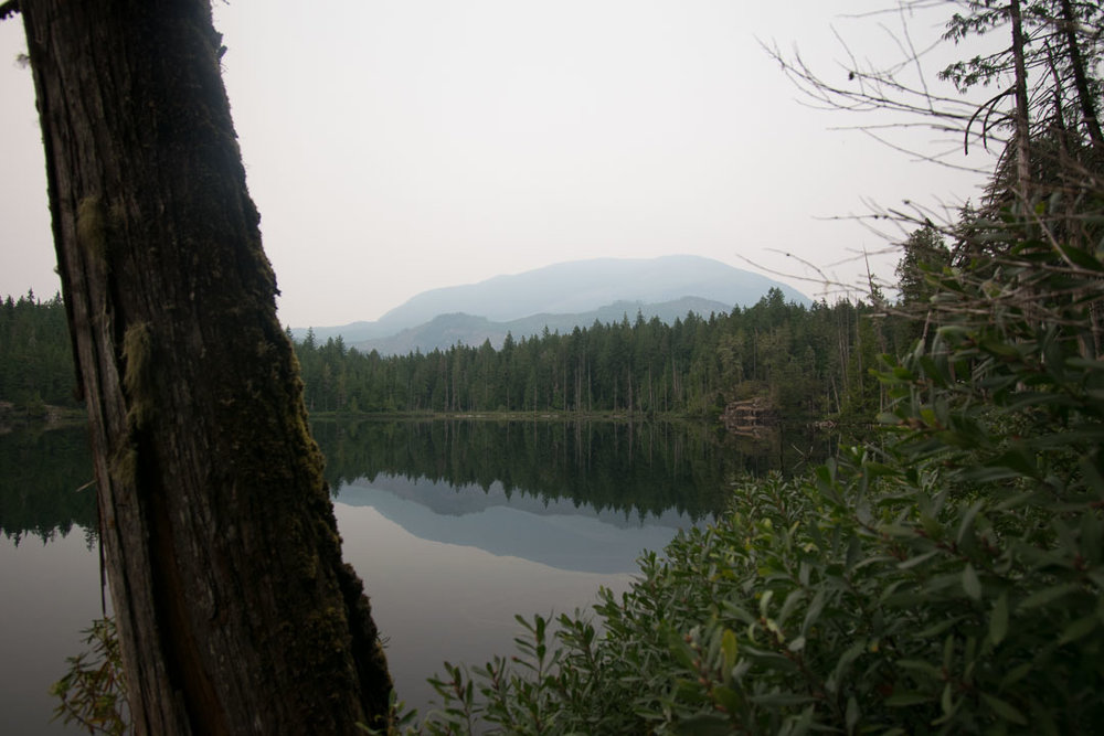 Mountains disappear in the smoky clouds