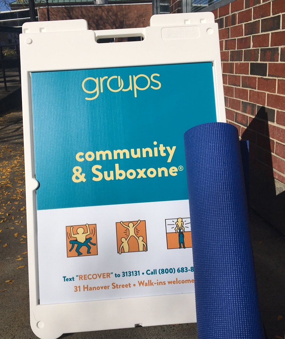 outside office with yoga mats.JPG