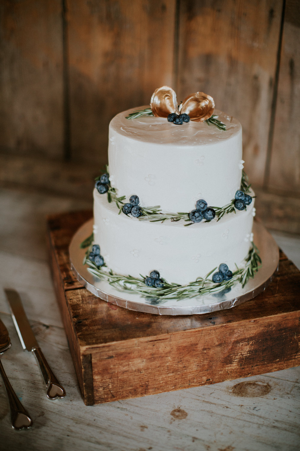 cake decorated with blueberries rosemary oyster shells maine