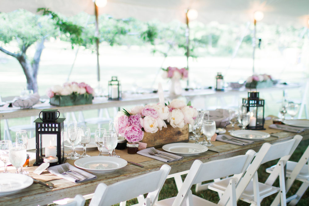 tent farm tables peonies wedding reception