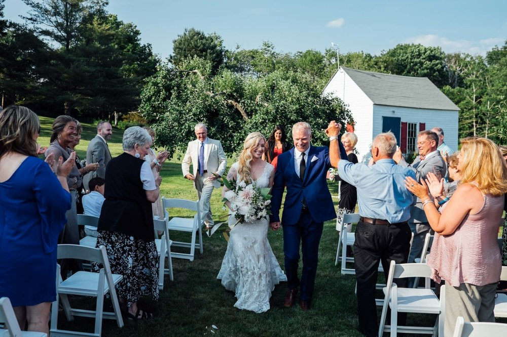 newlyweds married in apple orchard outdoor wedding maine