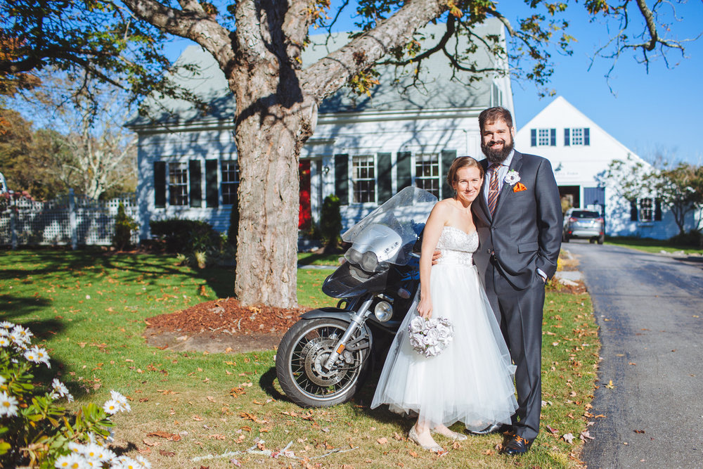 newlyweds with motorcycle in front of live well farm