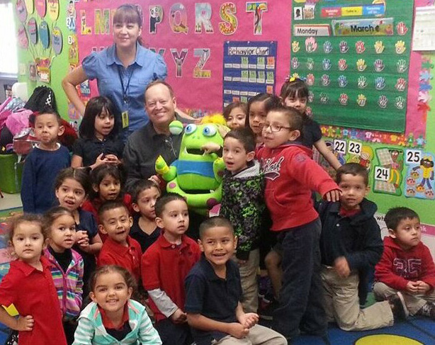 Award-winning children's author, Conrad J. Storad, with Story Monster and students at a KidsRead USA event in Phoenix, Arizona. As of March 2017. Conrad reached A Personal Goal of visiting with 1 million students.
