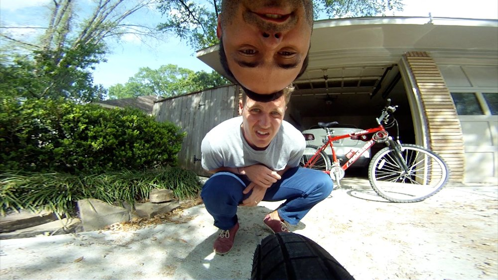 Jeff and Adam putting a GoPro on a bike for a project that never happened.