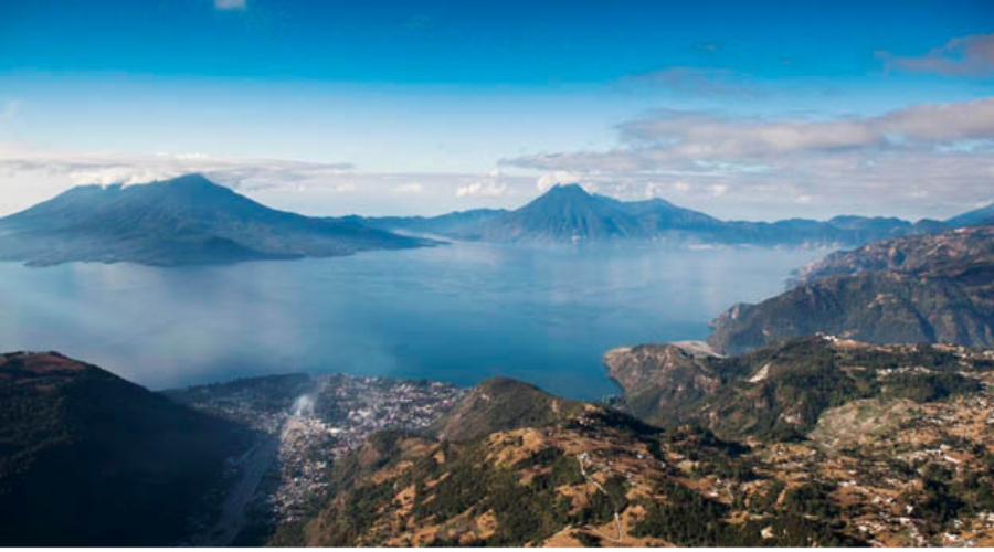 Breathtaking Atitlán Lake in Guatemala. You will set out in a boat to the other side to spend a day in a Mayan town.