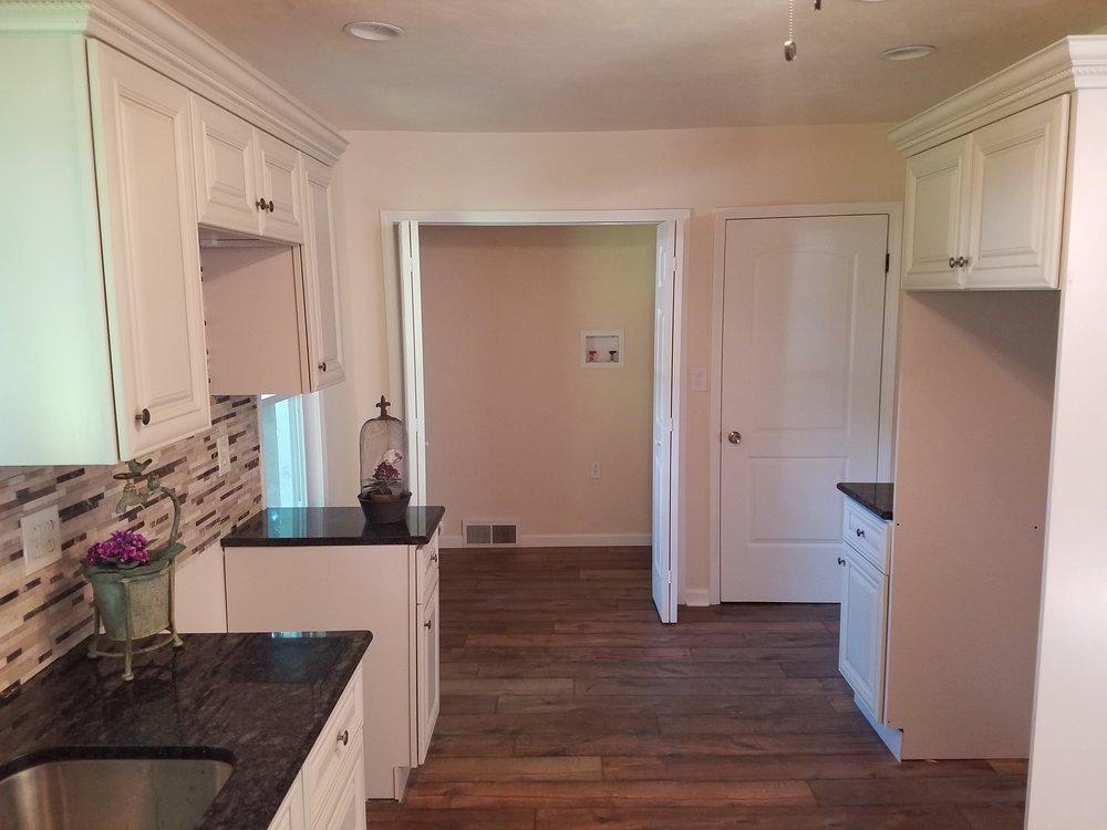 Newly remodeled kitchen with room for refrigerator,washer and dryer
