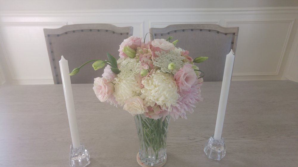 This romantic pink and white arrangement was one of two created for a housewarming party using the hosts' crystal vases.