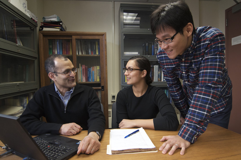 Mia discusses fluid dynamics with Professor Satish Kumar and colleague Chen-Yu Liu. Photo taken by Richard Anderson